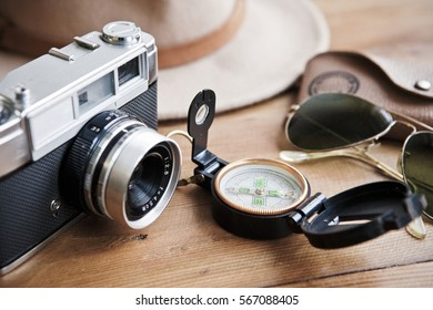 camera, compass, sunglasses and hat. Ready to adventures.