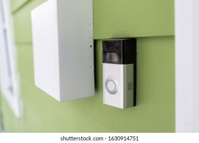 Camera Doorbell on front of green house