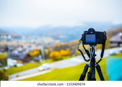 Camera DSLR on tripod for take photo in Italy.