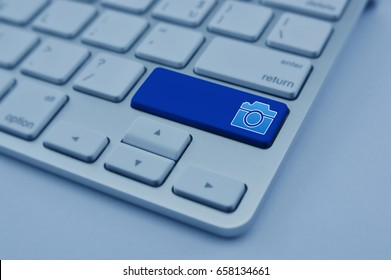 Camera flat icon on modern computer keyboard button, Business internet camera service concept