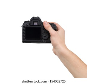 Camera in hand. Close-up of hand holding camera while isolated on white