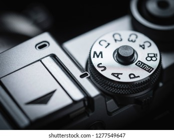 camera knob ring mode P M S A Av Tv lens focal length exposure compensation in macro and close up shot photo speed shutter dial ring button