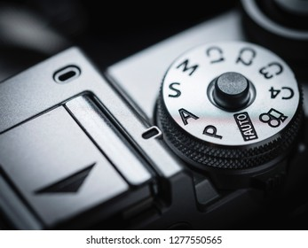 camera knob ring mode P M S A Av Tv lens focal length exposure compensation in macro and close up shot photo aperture priority mode dial button ring