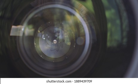 Camera lens aperture close up. Action. Outdoors view of a professional camera lense with aperture closed blades.