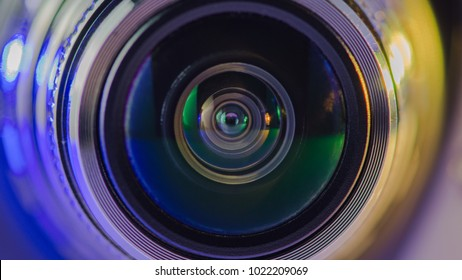 The camera lens and the beautiful multi-colored light blue and yellow (gold)