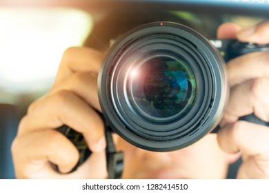 Camera lens with dust on the glass in the hand.