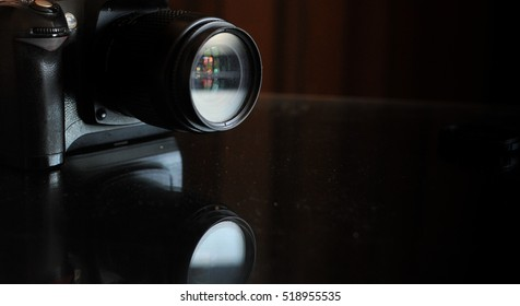 Camera lens isolated on the black background. Copy space