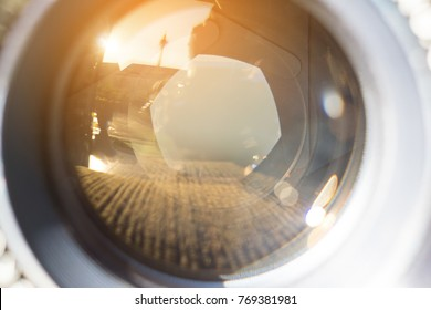 Camera lens with lense reflections selective focus.
