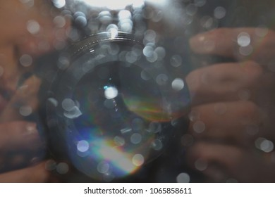 camera lens, mirror reflection with water drops. Camera lens in the mirror, with the effect of bokeh. Abstract background