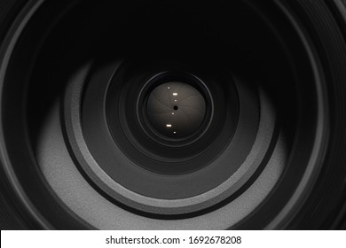 Camera lens on black background. Aperture blades. Camera lens close up.