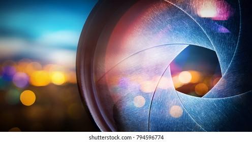 Camera lens on blur night city