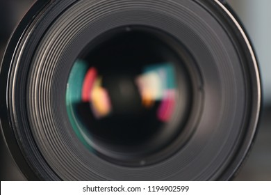 Camera lens of professional photographer, closeup view