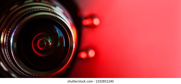 Camera lens and red backlight . Horizontal photography. Banner