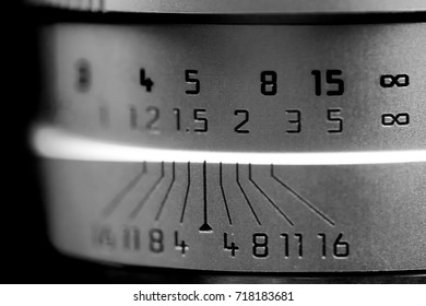 Camera lens scale show depth of field and focus distance , selective focus