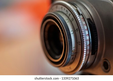 Camera Lense on a Colorful Blurred Background - February 2019