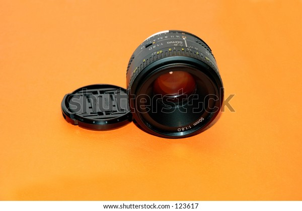 Camera lense - orange backgound