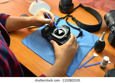 Camera maintenance in the workshop Photographers cleaning photocamera photocamera photographic care professional photography technology hobby