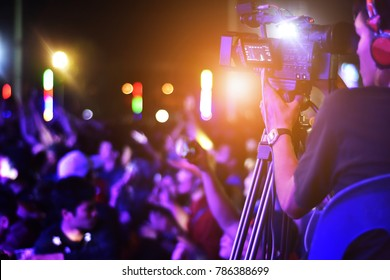 Camera man in live concert,Photographer video shooting in Concert