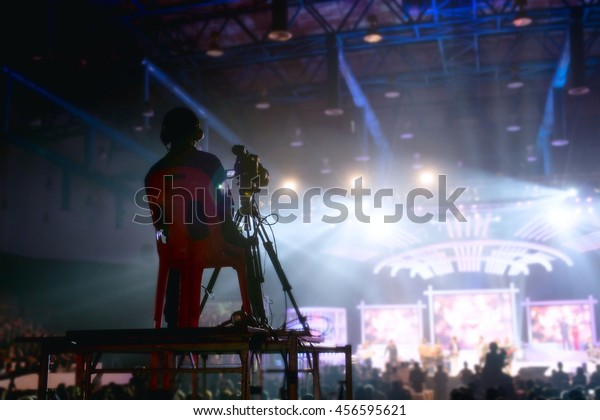 Camera man is making video of evening concert