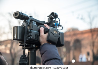 Camera man is making video in street