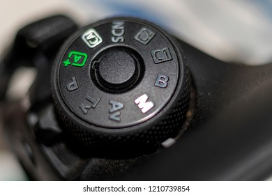 camera mode selector button. Button used to select between automatic and semi automatic modes of modern photo cameras and some analog cameras.