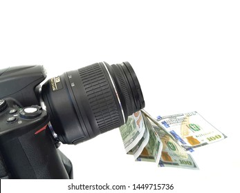 Camera and money, earnings for photographs on photostocks