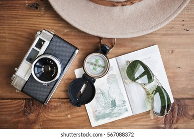 camera, passport, compass, sunglasses and hat. Ready to traveling.