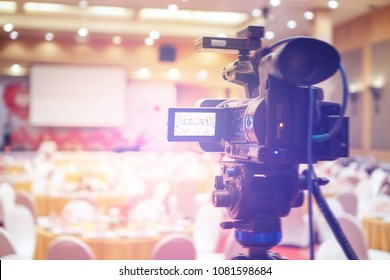 Camera ready to record at event room background