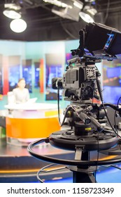 Camera in studio are broadcasting journalists reading news.Blur background have journalist or reporter.