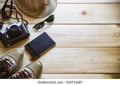 Camera and travel stuff on wooden background.Vintage style. Top view with copy space