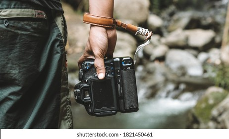 camera vintage background with camera in the palm of your hand