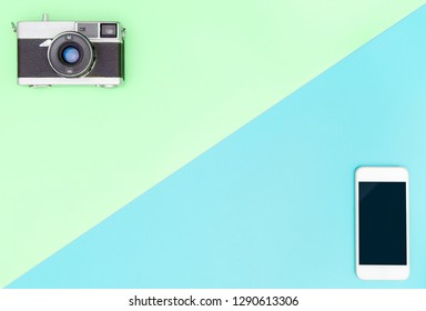 Camera VS smartphone with green and blue copy space