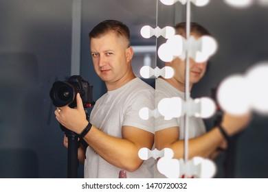 cameraman with a camera on a mono-pod at shooting