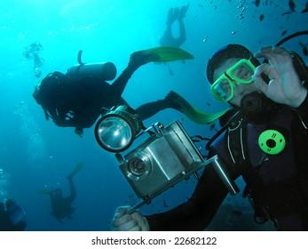 Cameraman and divers