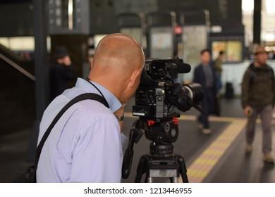 A cameraman filming a scene