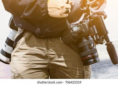Cameraman with his video camera shooting
