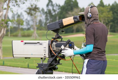 Cameraman live playing golf in golf course.