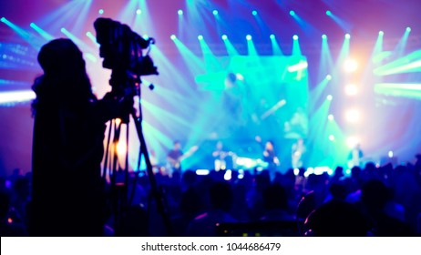 cameraman live streaming event production concert blurry defocus bokeh background