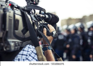 the cameraman make film captures the events on the street live television broadcast