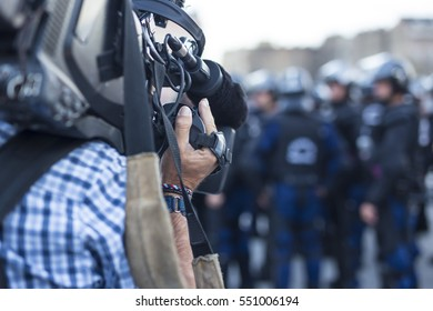 the cameraman make film, captures the events on the streets live television broadcast