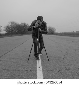 cameraman making a film analogue movie camera
