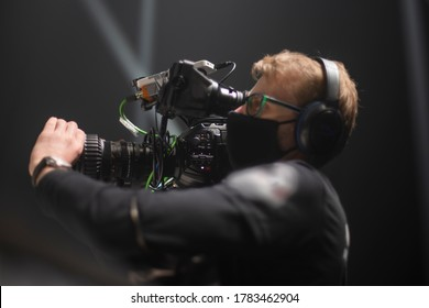 cameraman on the set of the ultimate fighting show. Masked against coronavirus