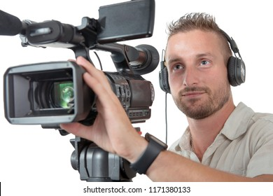 cameraman with professional camcorder and headphones isolated on white background