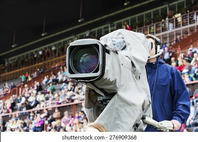 cameraman at the racecourse with blurry background