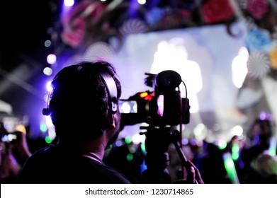 Cameraman recording concert event at night party concert,Recording night party concert  with video camera,Selective focus