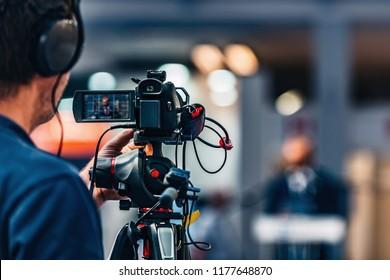 Cameraman recording at media press conference. Live streaming concept.