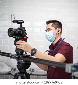 Cameraman shooting by Mirrorless with slider dslr video while wearing mask prevent Covid-19 or coronavirus quarantine pandemic and protect pm 2.5