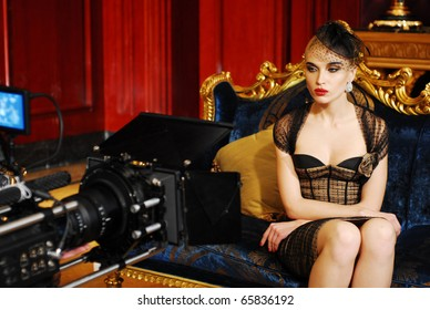 cameraman shooting film with beauty girl