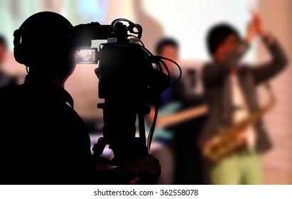 Cameraman shooting a live concert