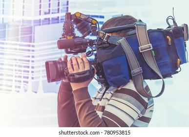 Cameraman shooting in studio